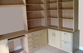 Fitted computer desk, drawer units, cupboards and shelf units in a home office